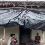 People living under foil dripping in rain