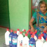 Women becoming self-sufficient by making phenyl at home